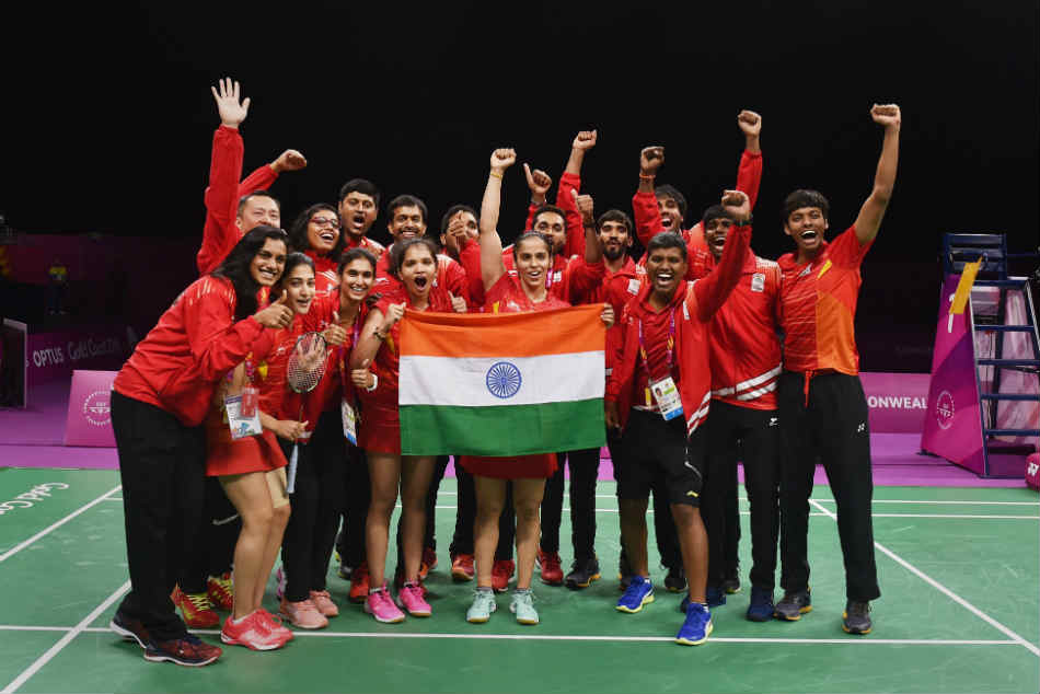 India team members pose after winning the team badminton gold in Commonwealth Games