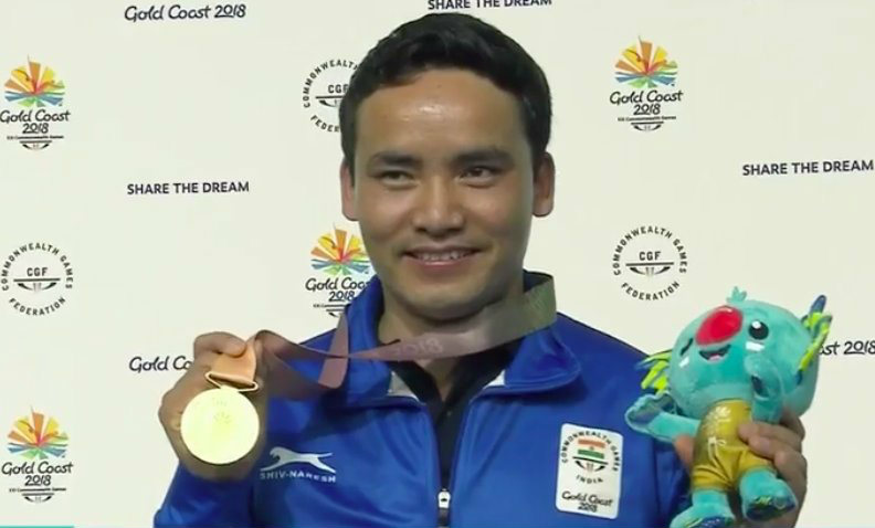 Jitu Rai poses with the 10M air pistol gold