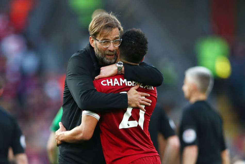 Liverpool boss Jurgen Klopp and Alex Oxlade-Chamberlain celebrate after win against Bournemouth