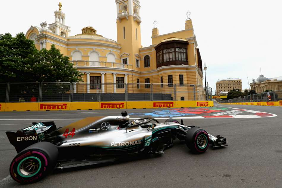 Hamilton wins chaotic Baku battle to lead title race