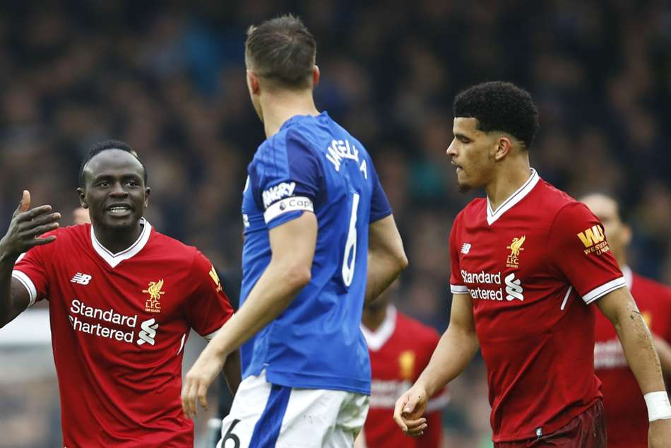 Sadio Mane (left) of Liverpool argues with Evertons Phil Jagielka during their Premier League match