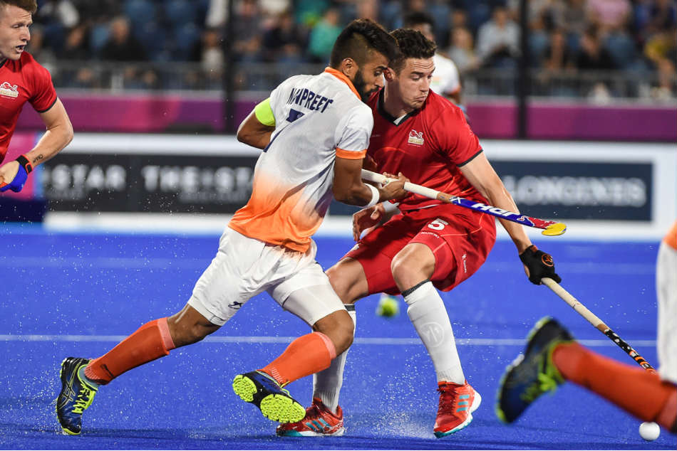 India captain Manpreet Singh in action against England during their Pool B encounter at the Commonwealth Games in Gold Coast on Wednesday