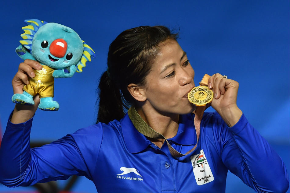 Gold medallist Mary Kom kisses her medal during the medal ceremony of the womens Light Fly (45-48kg) boxing event at the Commonwealth Games 2018 in Gold Coast on Saturday