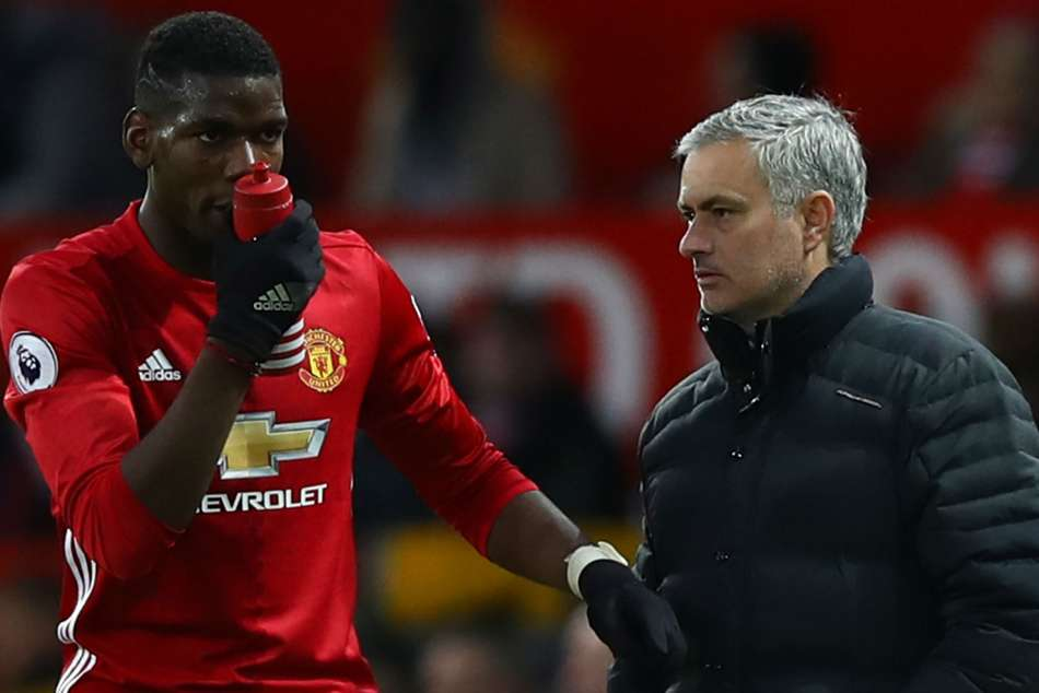 Manchester United manager Jose Mourinho (right) and Paul Pogba