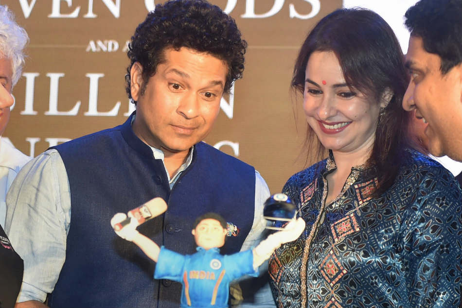 Sachin Tendulkar cuts a birthday cake with his wife Anjali at a book launch function in Mumbai on the eve of his birthday on Monday