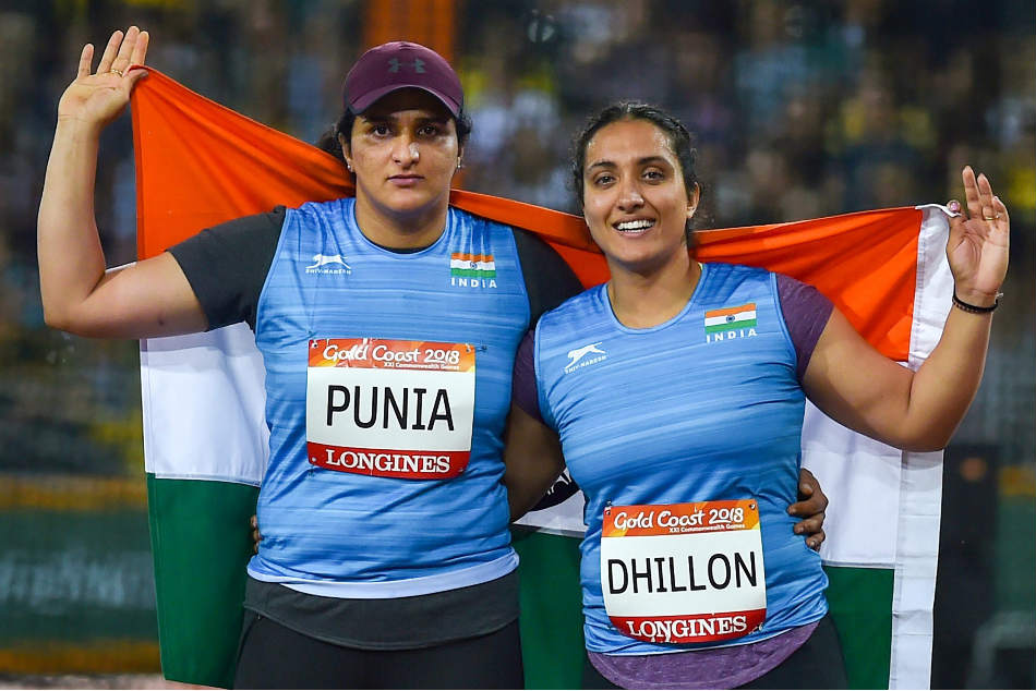 Silver medalist Seema Punia (left) and bronze medalist Navjeet Dhillon of India celebrate their win in the womens discus throw at the Commonwealth Games 2018 in Gold Coast on Thursday