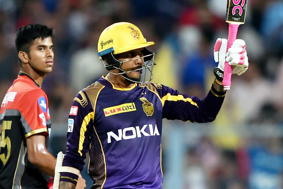Kolkata Knight Riders Sunil Narine celebrates his quickfire half century against Royal Challengers Bangalore during their IPL match at Eden Gardens in Kolkata