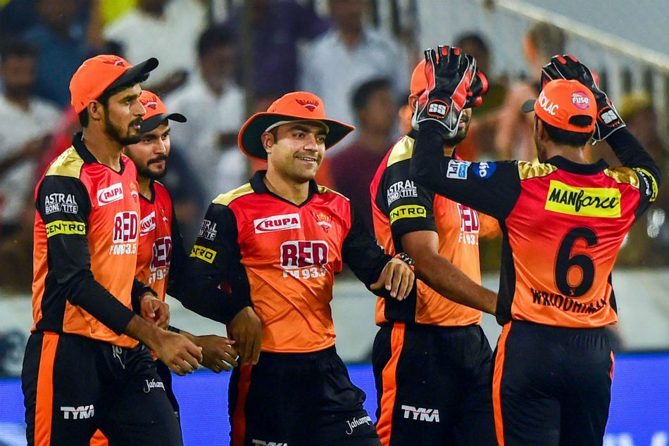 Sunrisers Hyderabad player Rashid Khan and other team players celebrate after taking a catch of Rajasthan Royals player Ajinkya Rahane.