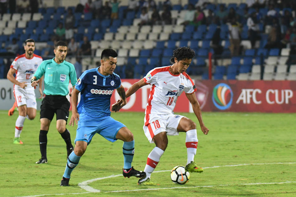 Thongkhosiem (Semboi) Haokip of Bengaluru FC vies for the ball with Haroon Amiri of New Radiant SC during their AFC Cup 2018 match at the Sree Kanteerava Stadium on Tuesday