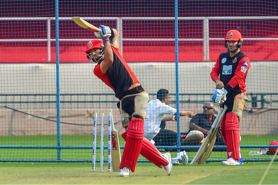 Virat Kohli, Royal Challengers Bangalore skipper, during nets as Brendon McCullum watches on