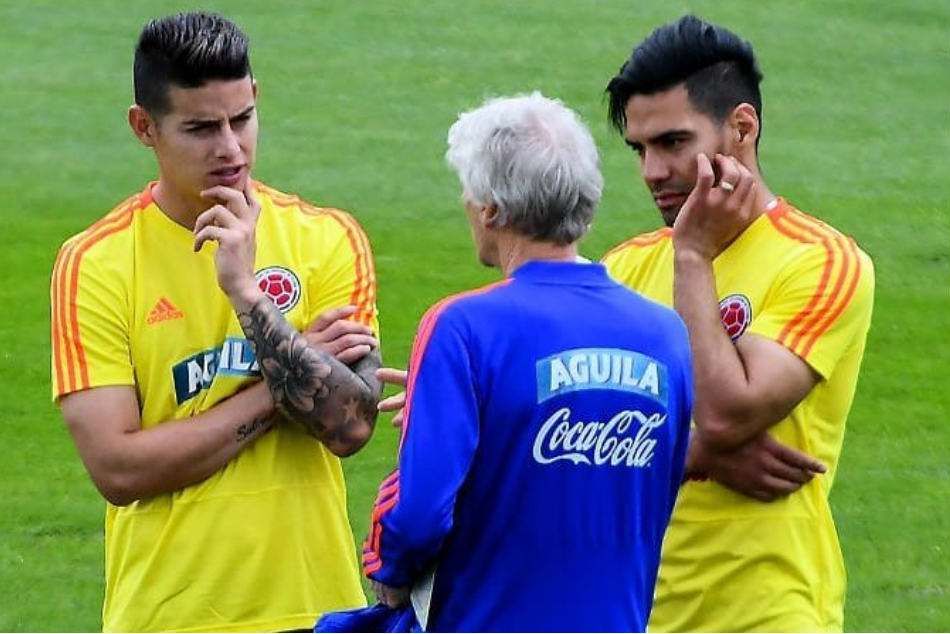 6f61862dc2f James Rodriguez (left) of Colombia with teammate Radamel Falcao (right) and  coach