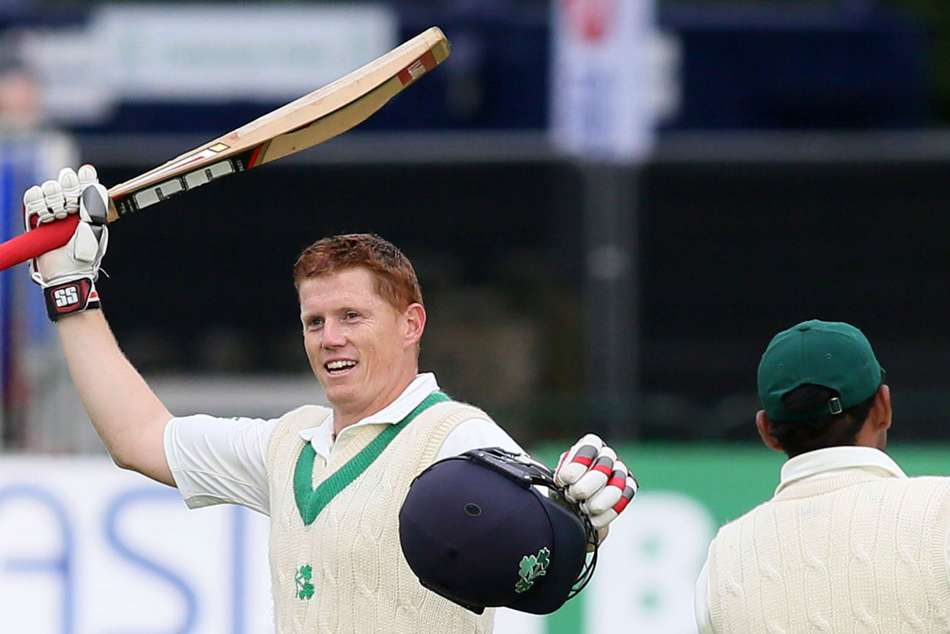 Kevin OBrien celebrates scoring a century in Irelands first ever Test match
