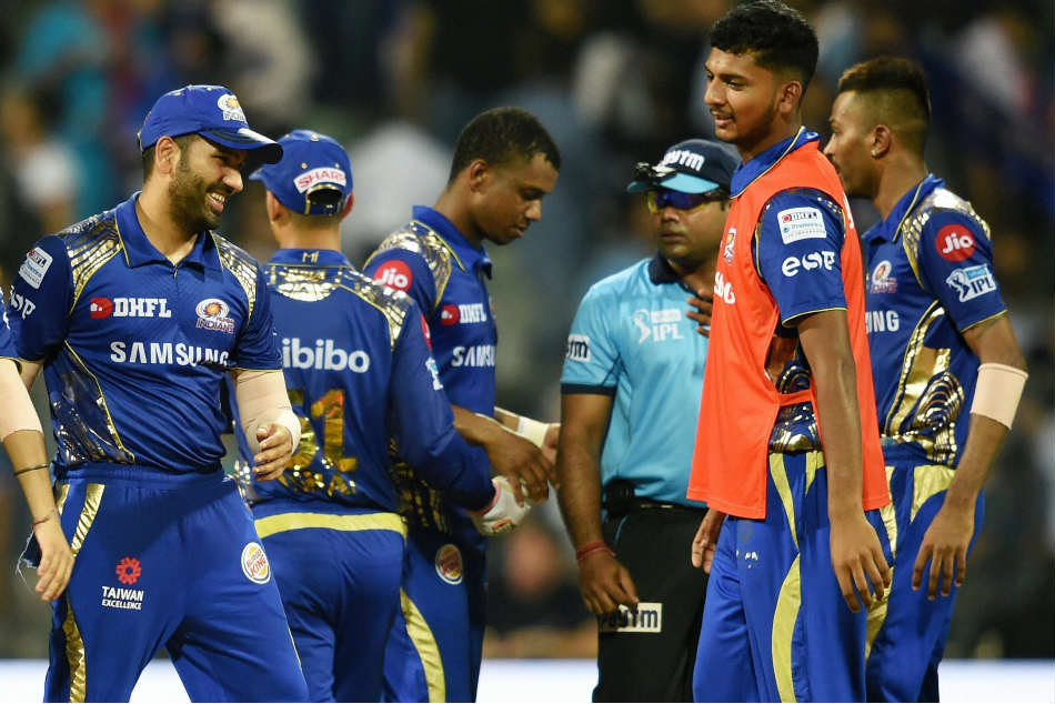 Mumbai Indians players celebrates after winning their crucial IPL match against Kings XI Punjab at the Wankhede Stadium in Mumbai on Wednesday