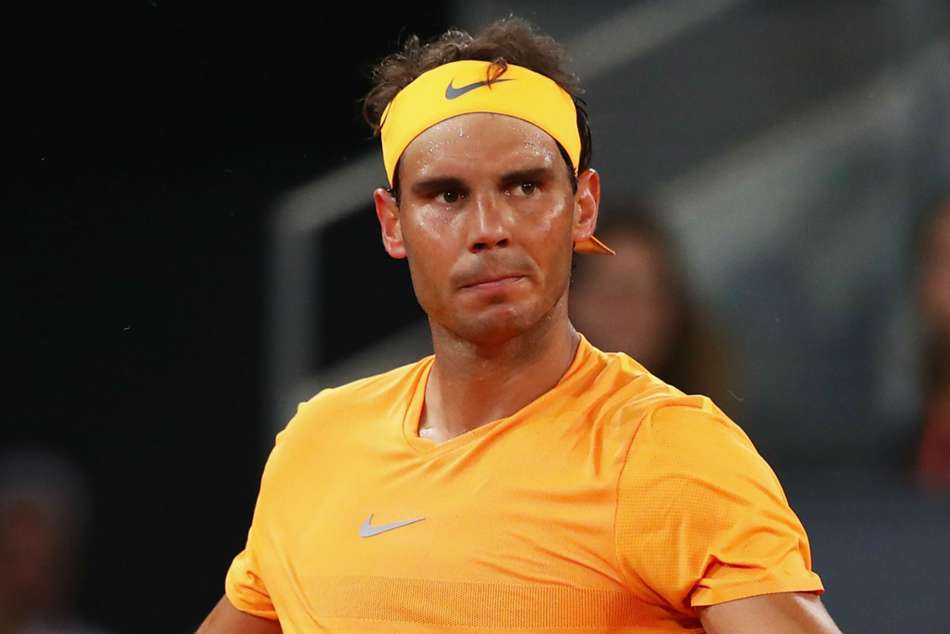 Nadal into last eight, but Halep fails to reach semis in Madrid