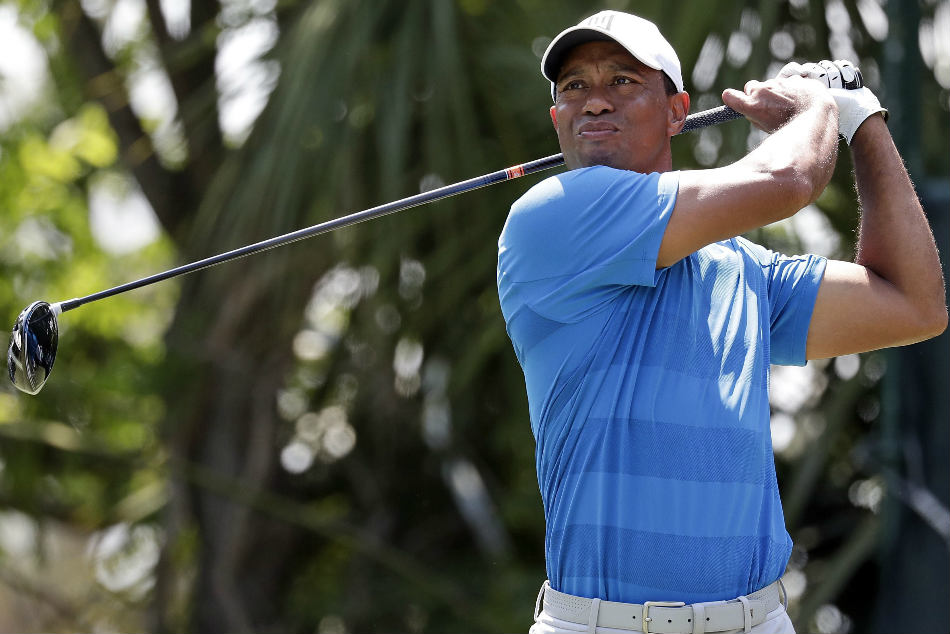 Lahiri Misses Cut Woods Squeezes Through