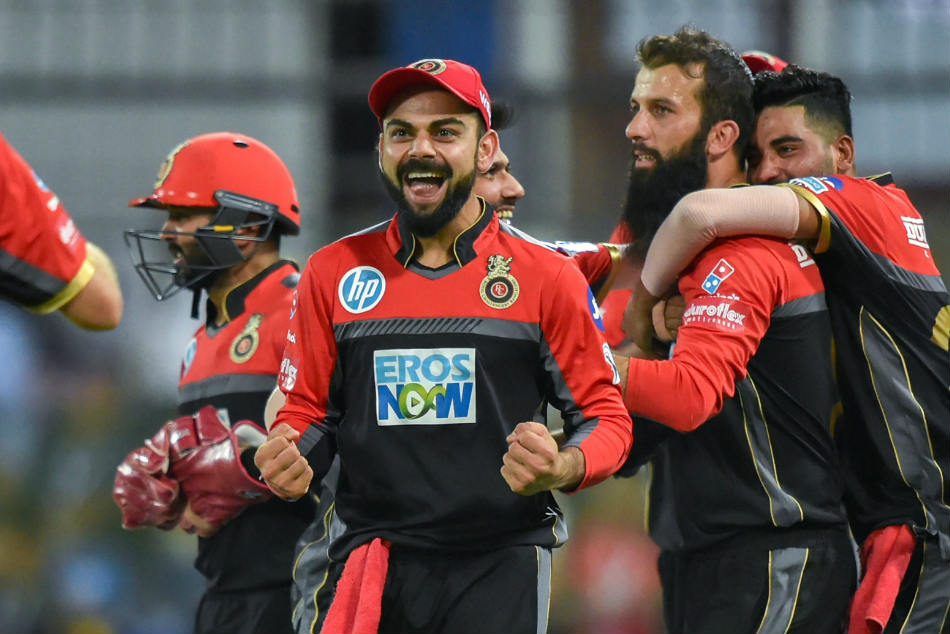 Virat Kohli (centre), Moeen Ali and Mohammed Siraj (right) of RCB celebrate a KXIP dismissal during their IPL 2018 game in Indore on Monday