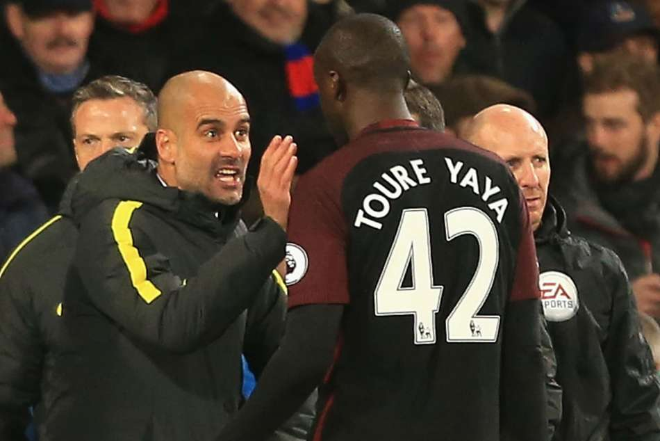 Manchester City coach Pep Guardiola and club legend Yaya Toure