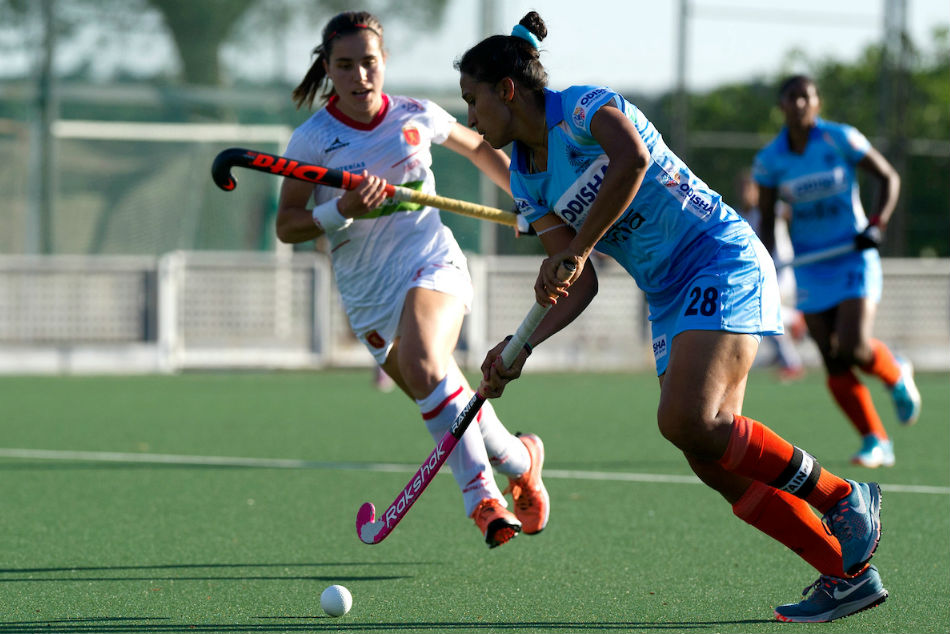 Indias Rani Rampal (right) in action against Spain