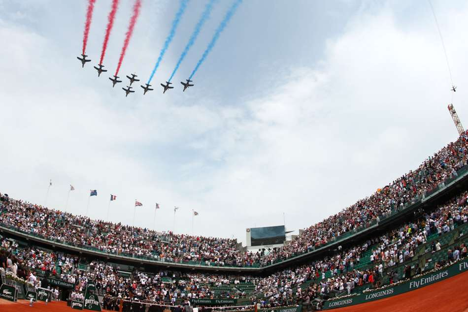 The crowd witnessed a flyby to mark the 100-year anniversary of the death of Roland Garros