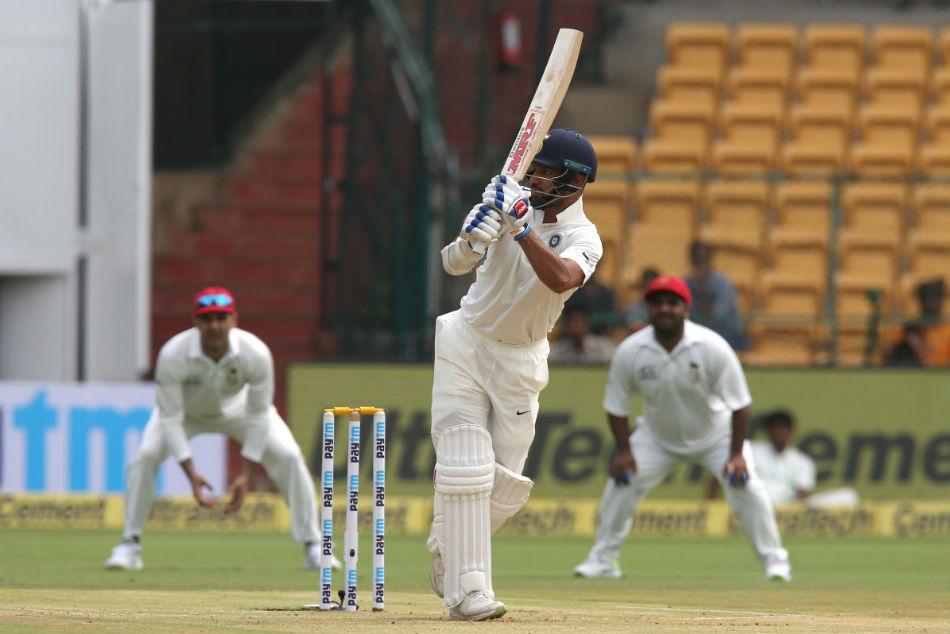 India Vs Afghanistan Lone Test Day 1 Match Report Bengaluru Shikhar Dhawan Murali Vijay Shine