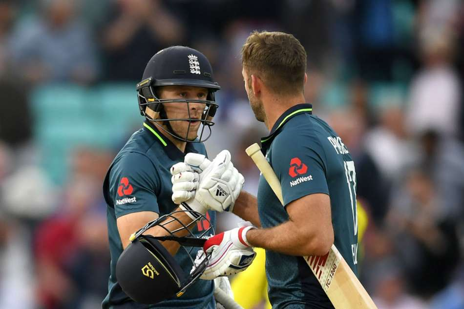 David Willey (left) and Liam Plunkett celebrate after helping England past Australia