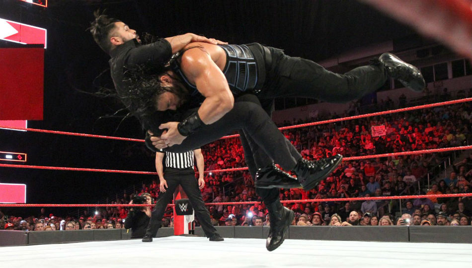 Roman Reigns (right) spears Sunil Singh (image courtesy WWE.com)