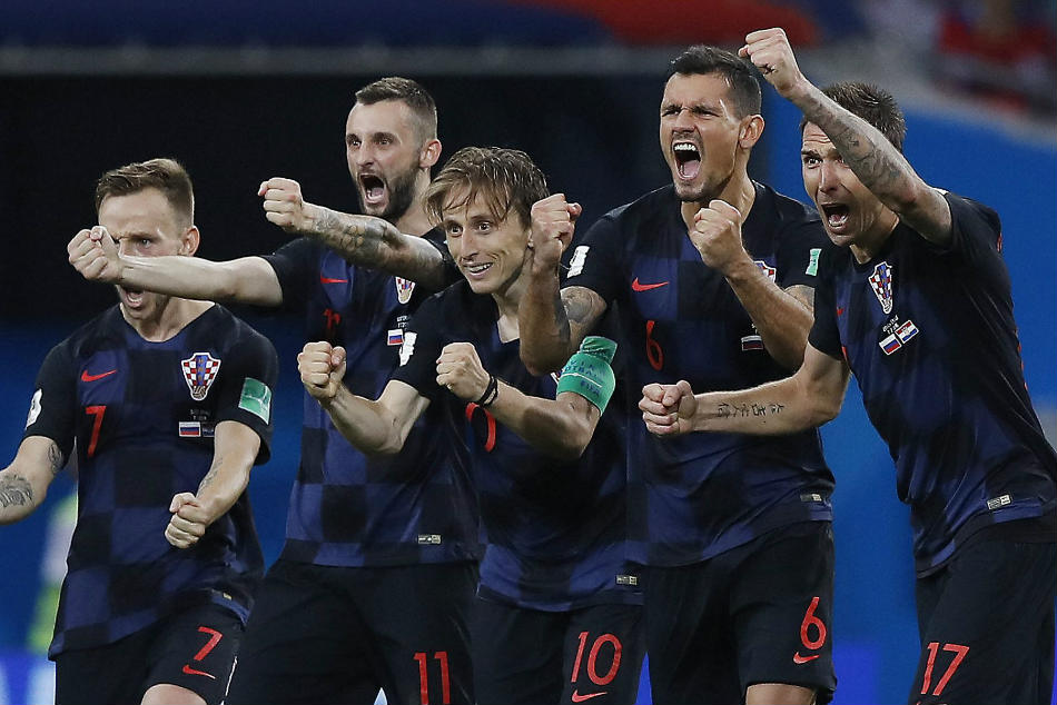 Croatia players celebrate after their penalty shootout win over Russia in the FIFA World Cup 2018 quarterfinal in Sochi