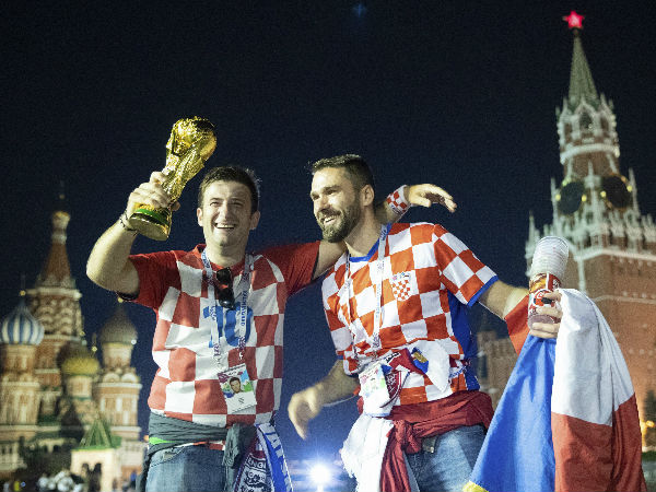 Croatias soccer fans celebrate with a model of the World Cup trophy in Red Square as their team won the semifinal against England