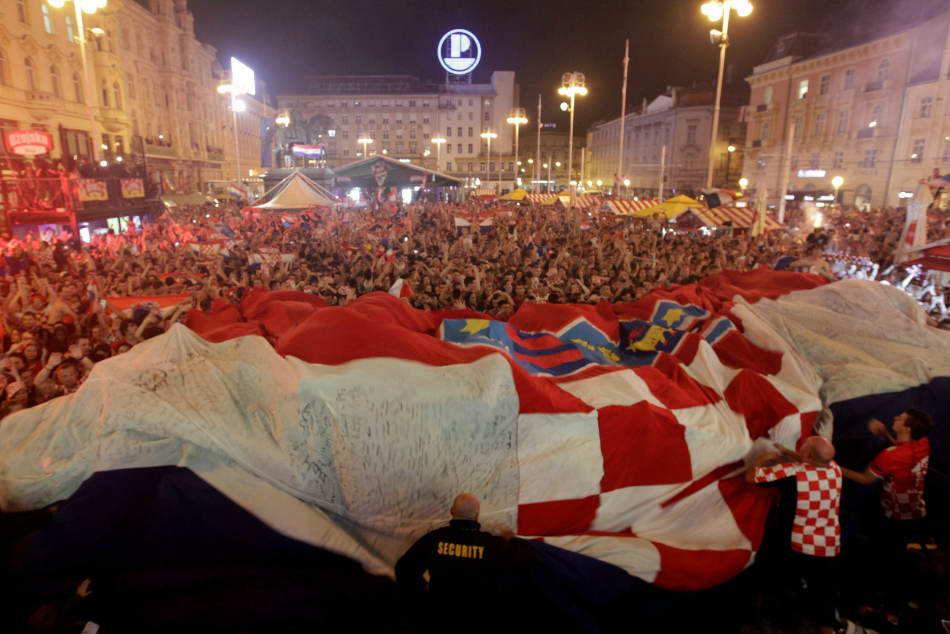Croatia fans celebrate at the end of the semifinal match between Croatia and England in Zagreb, Croatia on Wednesday