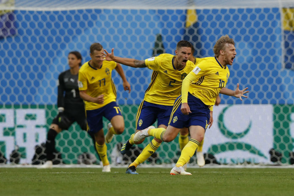 Swedens Emil Forsberg, right, celebrates with teammates after scoring the winner