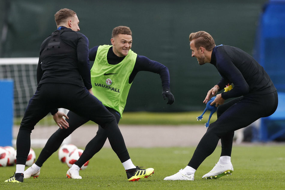 England captain Harry Kane (right) plays a game of tag with Kieran Trippier (centre) and Phil Jones at their training facility for the FIFA World Cup 2018 in Saint Petersburg