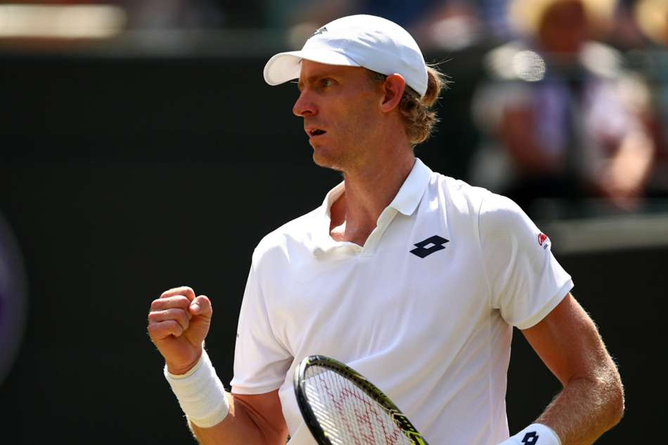 Kevin Anderson of South Africa celebrates after a point against Roger Federer of Switzerland during their Wimbledon 2018 quarterfinal