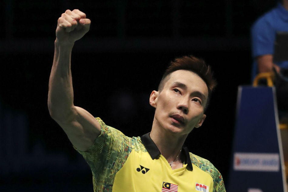 Malaysias Lee Chong Wei, celebrates after beating Japans Kento Momota during the mens singles final of Malaysia Open badminton in Kuala Lumpur