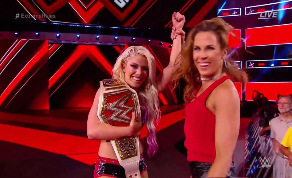 Alexa Bliss (left) celebrates with Mickie James(courtesy Twitter)