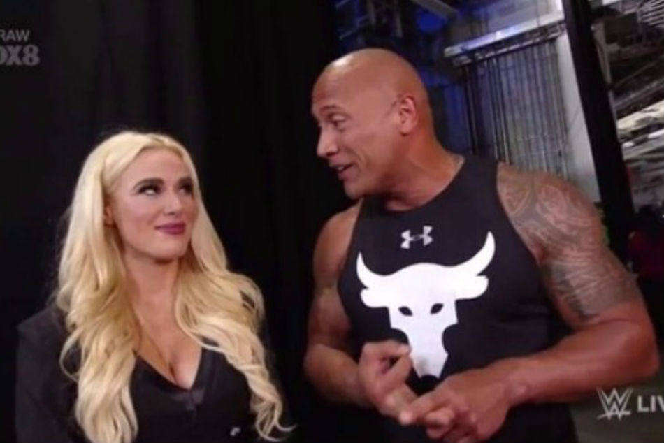 The Rock (right) during his final appearance on WWE Raw (image courtesy Youtube