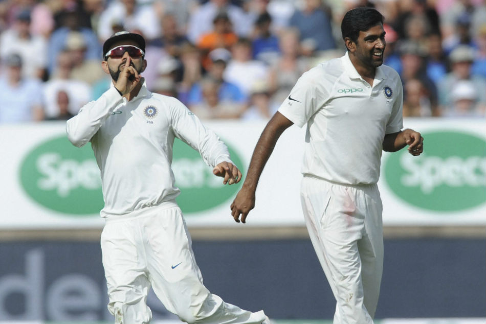 R Ashwin and Virat Kohli celebrate the fall of an England wicket on the opening day of the 1st Test