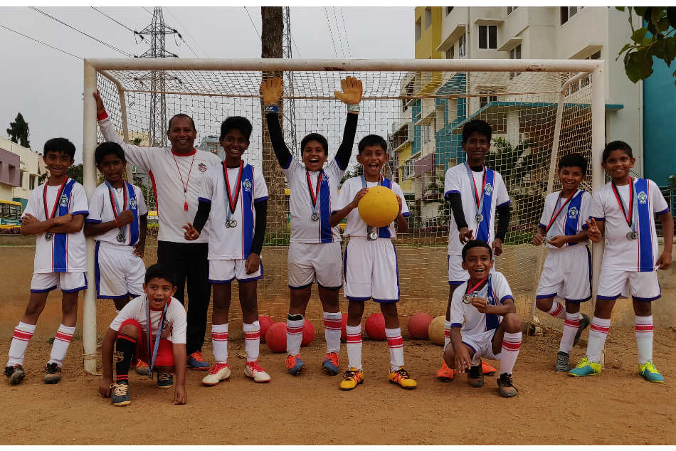 Fatima XI Soccer Academys U-11 boys pose with the silver medals they bagged from Swedens Gothia Cup and Denmarks Cup No 1 youth football tournaments. Coach Clifford Arland is also pictured with them