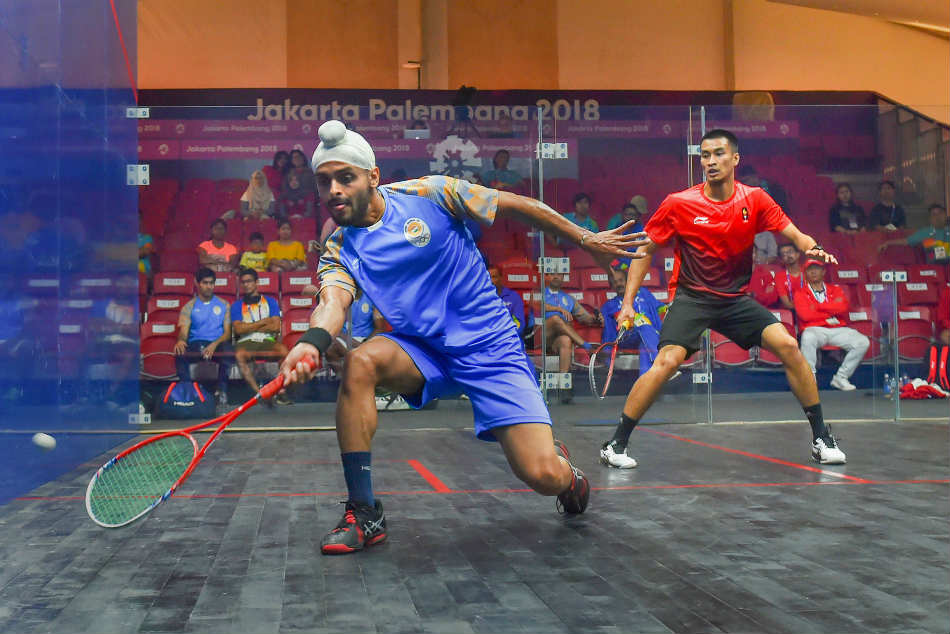 Harinder Pal Sandhu of India in action in the mens team squash event at the Asian Games 2018
