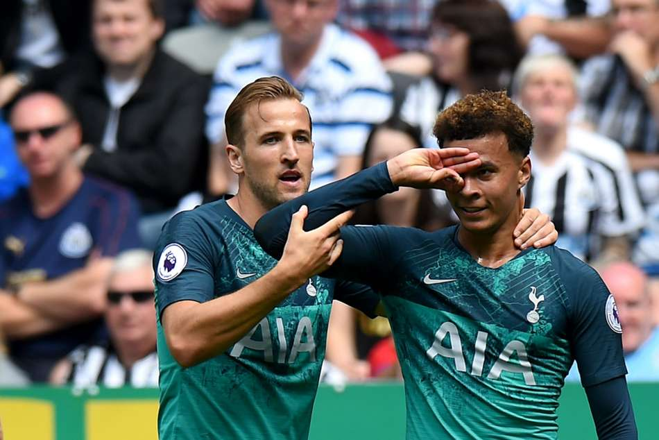 Harry Kane and Dele Alli of Tottenham Hotspur celebrate after a goal against Newcastle United
