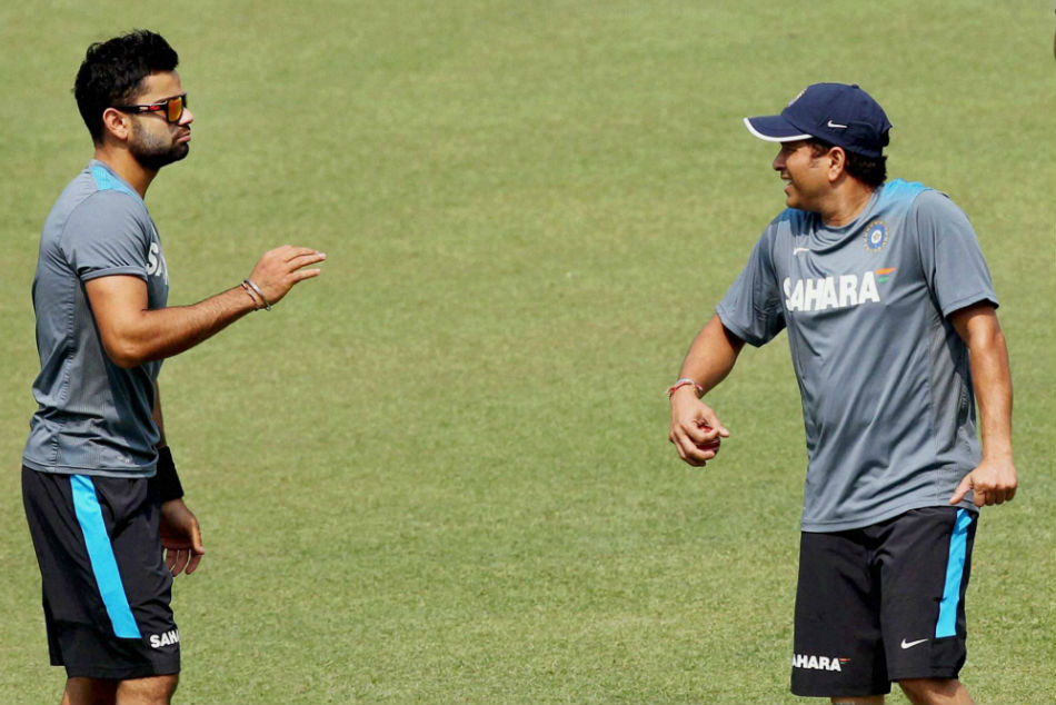 A file picture of Virat Kohli with Sachin Tendulkar (right)