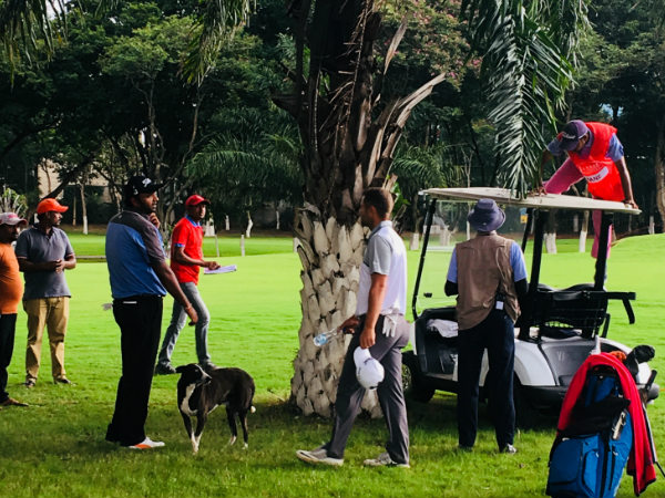 Udayan Mane tries to retrieve his golf ball which got caught in the tree. Credit: Chitrangada