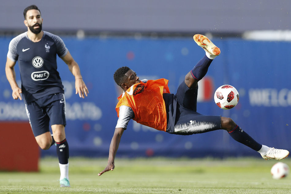 France international Ousmane Dembele (right) wants to stay at Barcelona