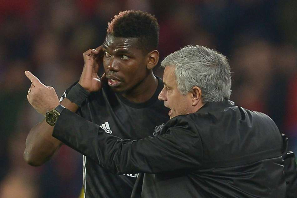 Manchester United star Paul Pogba (left) linked with big money move to Barcelona