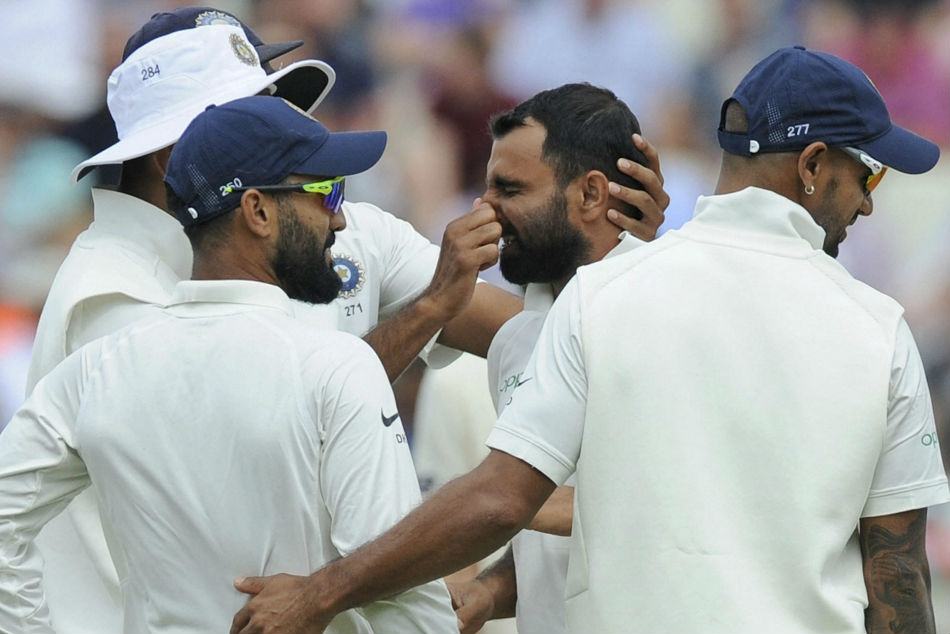 Mohammed Shami celebrates with teammates after picking up an England wicket