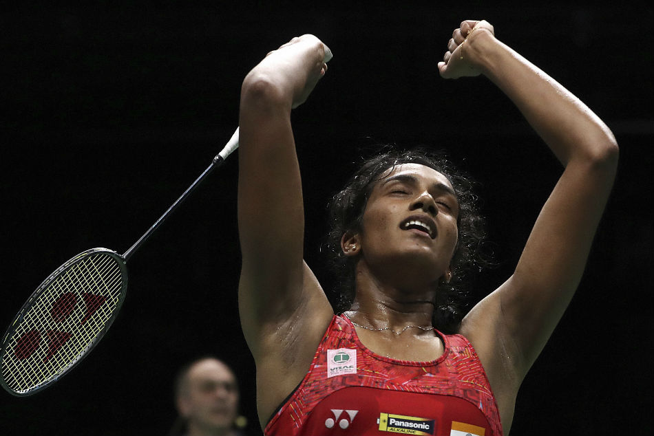 PV Sindhu celebrates after defeating Akane Yamaguchi to enter the final of the World Championships