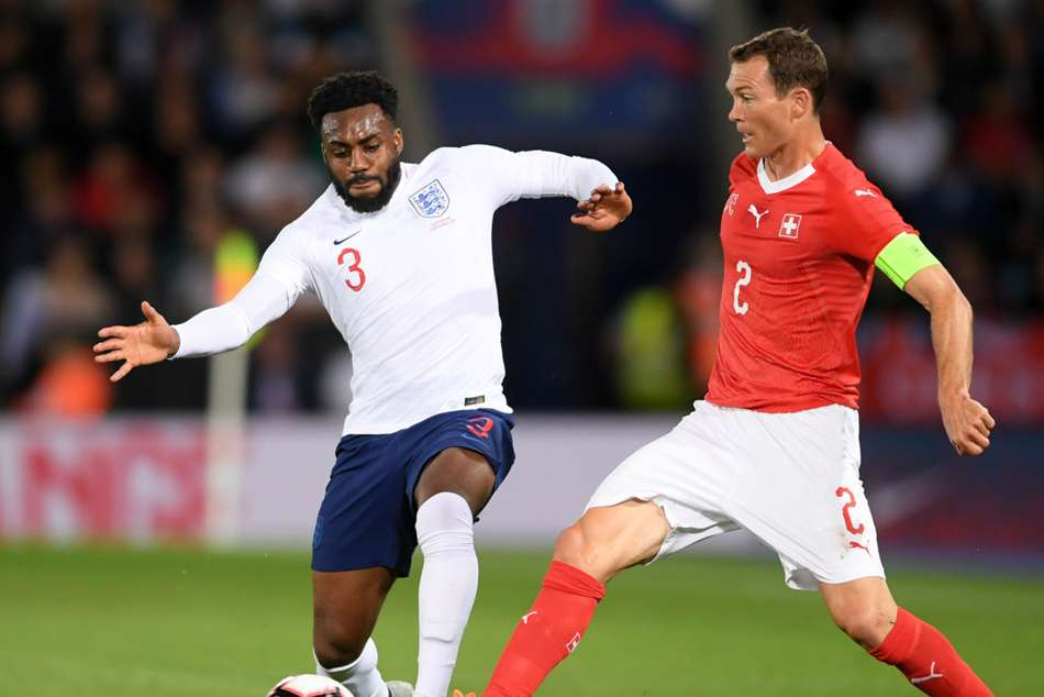Englands Danny Rose (left) battles for the ball with Switzerllands Stephan Lichtsteiner
