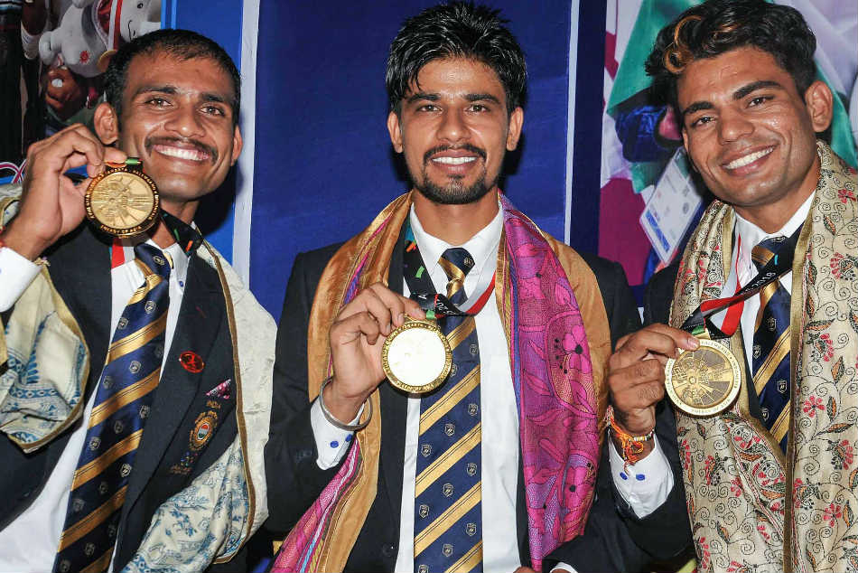(From left) Asian Games gold medallists Dattu Bhokanal and Sukhmeet Singh and bronze medalist Dushyant Chouhan during a felicitation ceremony in Kolkata on Saturday