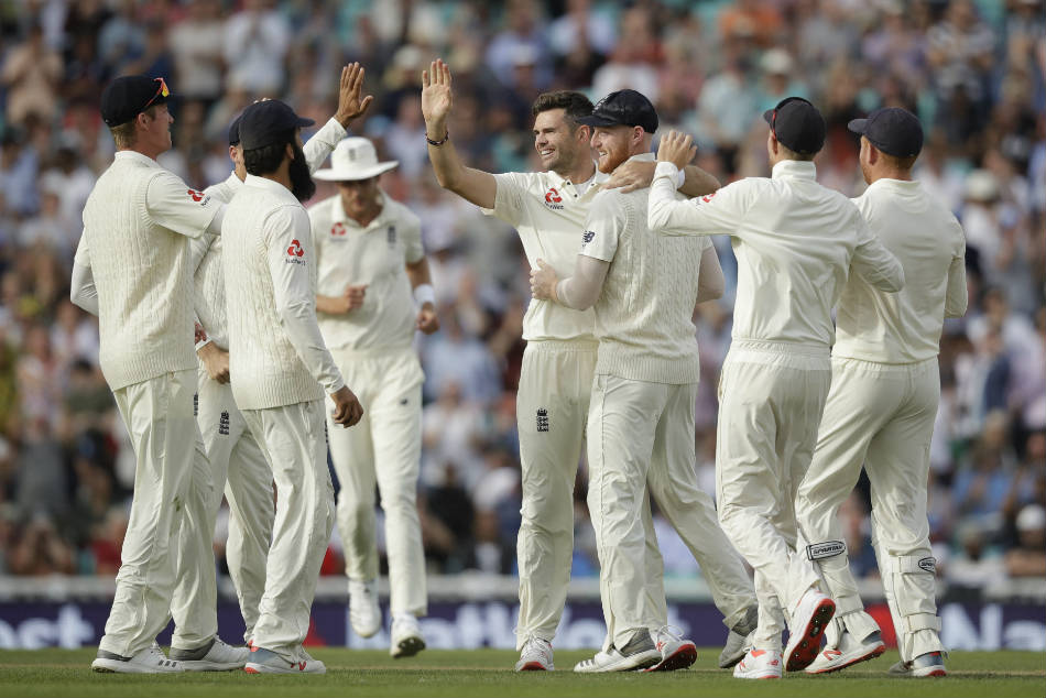 Englands James Anderson celebrates with teammates after dismissing an Indian batsman during the fifth Test at Oval