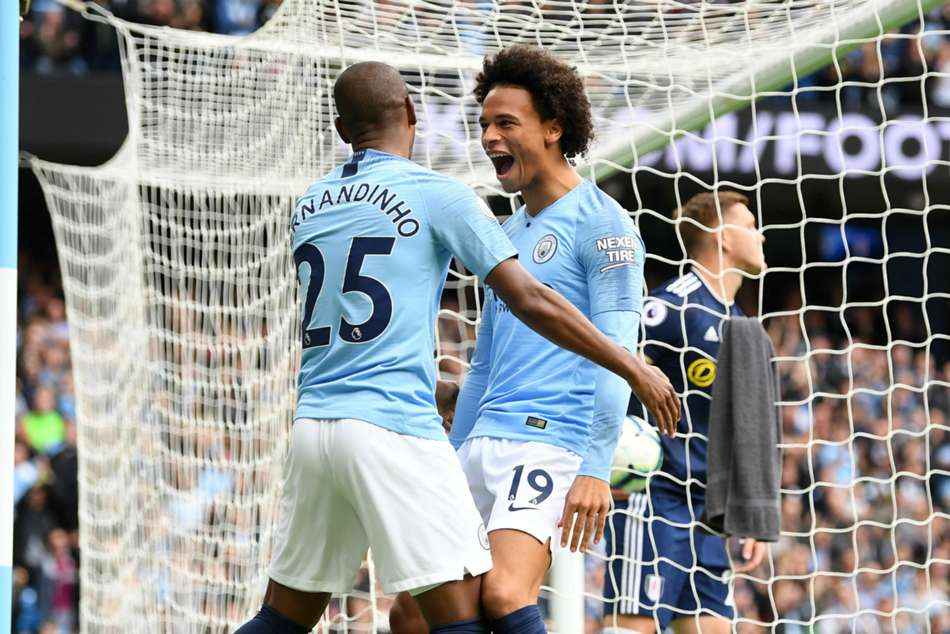 Fernandinho and Leroy Sane celebrate a goal against Fulham during their Premier League match on Saturday