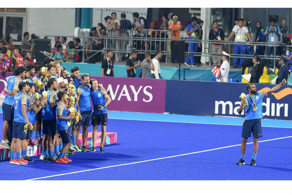 PR Sreejesh (right) takes a selfie with his hockey teammates after their bronze medal playoff against Pakistan at the Asian Games 2018